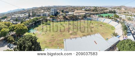 WINDHOEK NAMIBIA - JUNE 17 2017: An aerial panorama of the eastern parts of Windhoek the capital city of Namibia. The Tintenpalast Windhoek High School and its sport stadium are visible