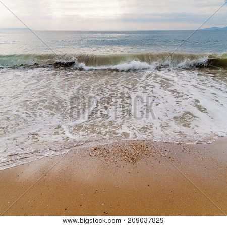 Big wave on sea with beach background