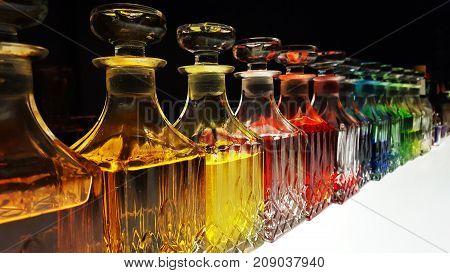 A bartender's glass bottle of variety liquors