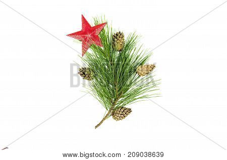 Fir tree branches with cones and decorative red toy star isolated on white background. Christmas pine tree branches decoration isolated.