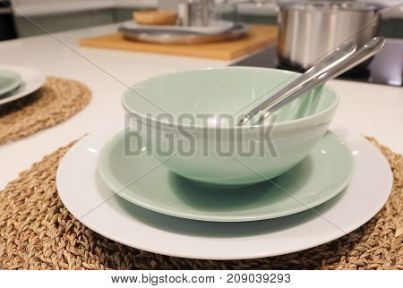 Kitchen Utensil Collection of Ceramic Plates Bowls and Cutlery Preparing for Special Dinner or Lunch.