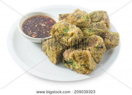 Plate of Fried Chinese Pancake or Fried Steamed Dumpling Made of Garlic Chives Rice Flour and Tapioca Flour Served with Spicy Soy Sauce. Traditional Food of China.