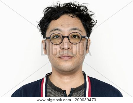 Asian guy is staring to camera