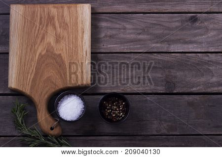 Cutting Board, Rosemary And Spices On A Old Wooden Table. Copy Space. Concept For Restaraunt Cafe Bi