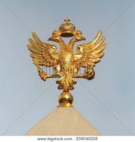 MOSCOW, RUSSIA, AUGUST 24, 2017: Golden Coat of arms of the Russian Federation close-up on the background of the sky