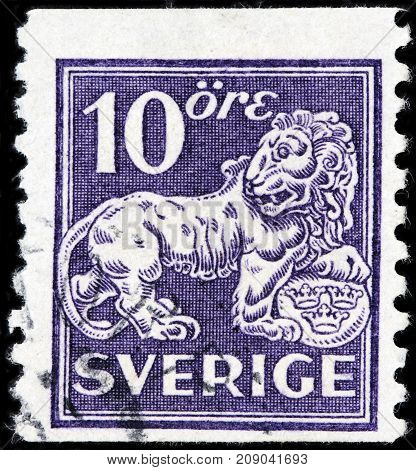 LUGA RUSSIA - AUGUST 20 2017: A stamp printed by SWEDEN shows Swedish Standing Lion circa 1925