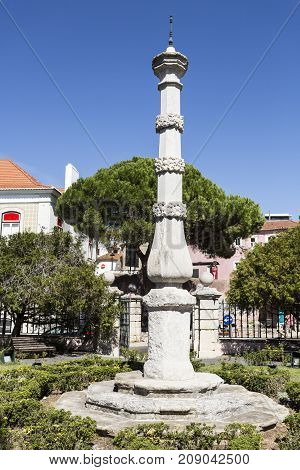 OEIRAS, PORTUGAL - September 17, 2017: Pillory of Oeiras built in the eighteenth century made of lioz limestone with na octogonal perimeter and topped by a bronze spike.
