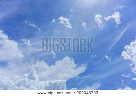Beautiful white clouds and blue sky background