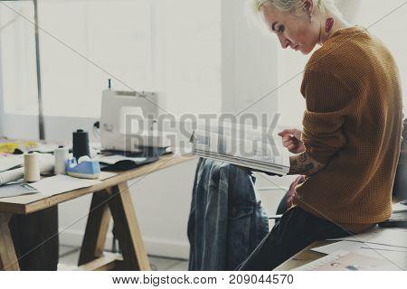 Fashion Designer Magazine Reading Concept