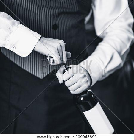 Sommelier Opening Wine Bottle, Black And White Image