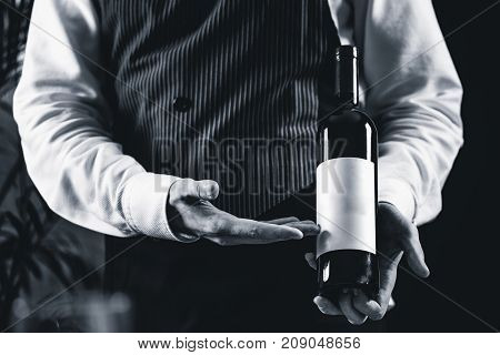 Sommelier With Bottle Of Wine, Black And White