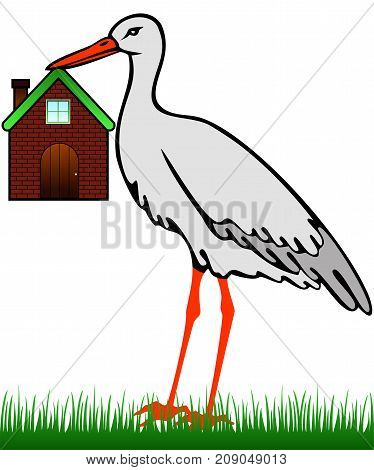 A stork in the grass holds a house in its beak
