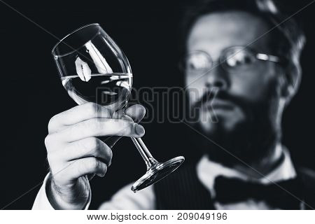 Sommelier Examining White Wine, Black And White