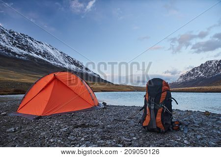 Campsite and Tent with Snow-capped peaks in the Mountains