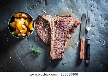 Tbone Steak And Chips With Salt And Rosemary