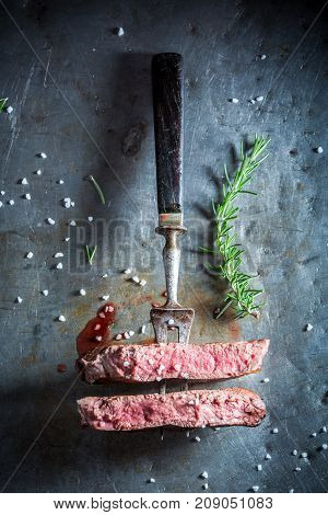 Top View Of Steak With Salt And Rosemary