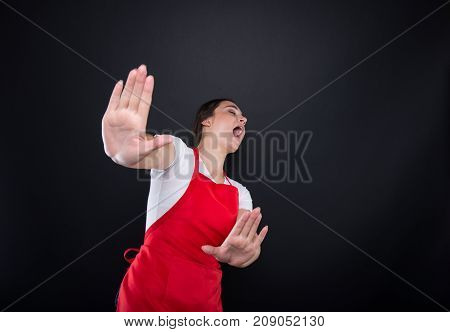 Scared Female Seller Doing Rejection Gesture With Hands