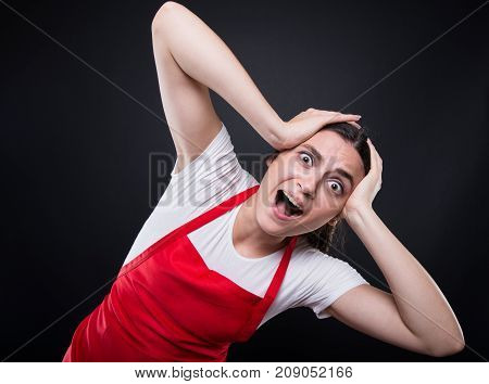 Terrified Girl With Apron Holding Her Head