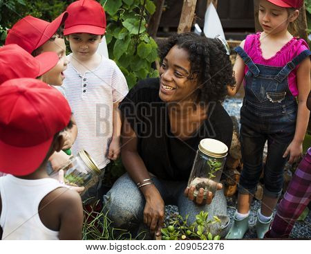 Teacher and kids having fun learning about plants