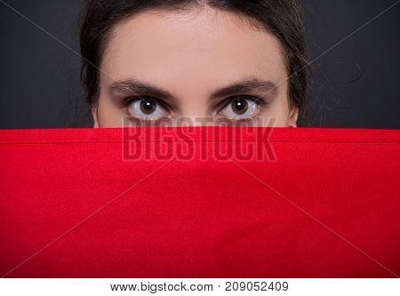 Closeup Of Female Employee Hiding Behind Apron