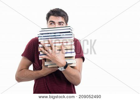 Handsome Student Posing Hiding Behind Pile Of Books