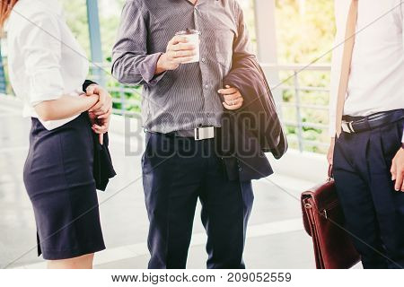 Asian Group Of Business People Talking In Outdoor After Work
