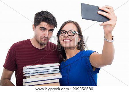 Student Couple Taking Seflie Holding Books