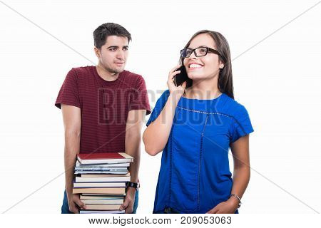 Student Girl Talking At Phone With Boy Caring Books