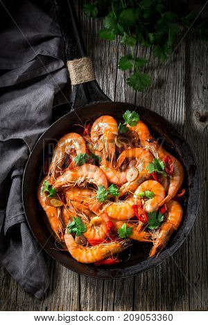 Tasty Shrimps On Pan With Parsley And Garlic