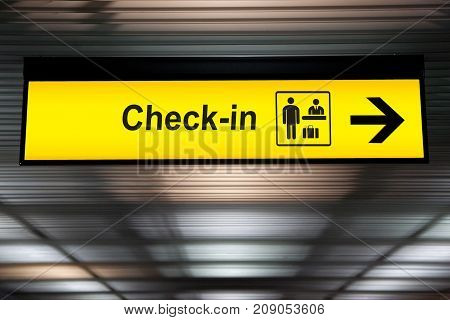 check in information sign at the airport.