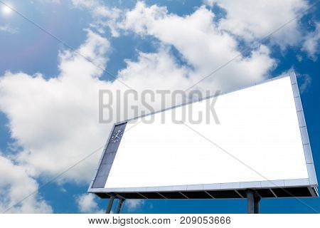 Blank white billboard at blue sky background with analog clock