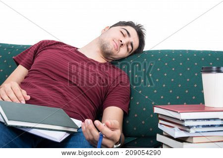 Student Boy Taking Nap While Studying On Couch