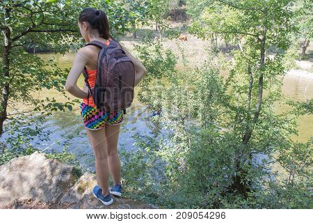 Traveler travel In the reserve. Active and healthy lifestyle on summer vacation and weekend tour. hiker girl of tourists hitching a ride. summer vacation and weekend tour