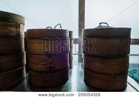 Dim sum bamboo basket containers in a restaurant Chinese food .