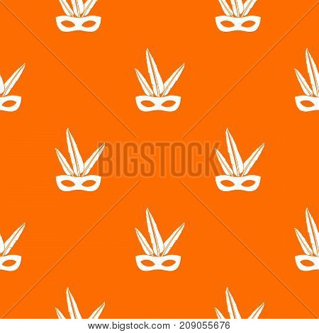 Carnival mask pattern repeat seamless in orange color for any design. Vector geometric illustration