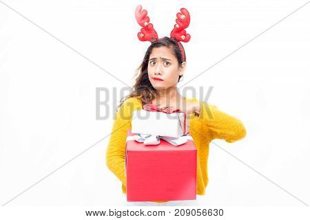 Misunderstanding pretty woman holding gift boxes and looking with confusion at camera. Puzzled young girl buying Christmas presents. Purchase concept