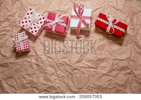 Gifts on crumpled  kraft paper