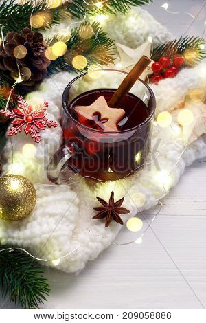 Christmas mulled wine.Traditional german Gluhwein with spices and apple slices. Copy space