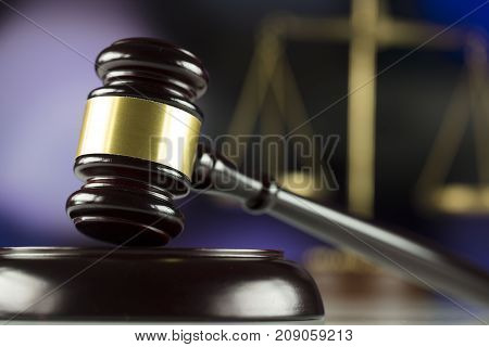 Law theme. Gavel, book and scales on bokeh background.