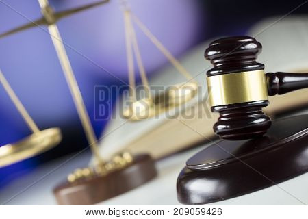Law concept. Gavel and scales on bokeh background.