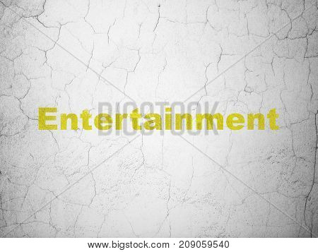 Entertainment, concept: Yellow Entertainment on textured concrete wall background