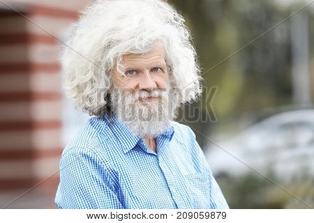 Mature man with grey hair outdoors