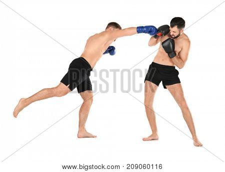 Male kickboxers fighting on white background