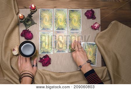 Tarot cards on wooden desk table of fortune teller. Tarot reading.