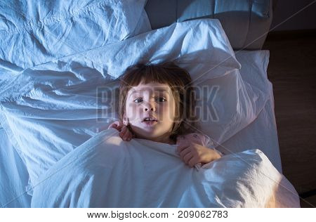 A Girl Of 4 Years Is Afraid Of Lying In Bed