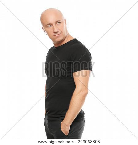 Bald man in black t-shirt on white background
