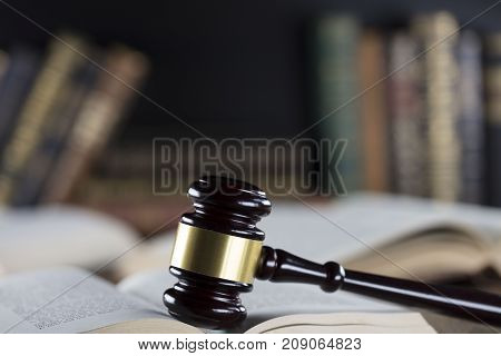 Court library - gavel of the judge and books.