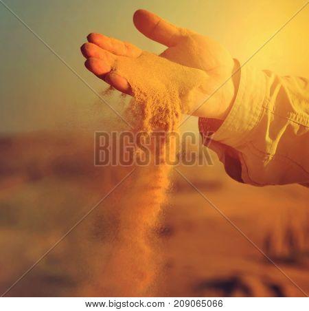 sand in hands of desert concept vintage nature background