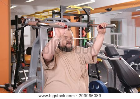Overweight man training in gym