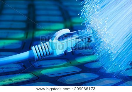 network cables closeup with fiber optic background